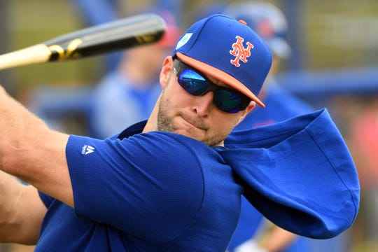 New York Mets outfielder Tim Tebow gets in a few practice swings as he runs through batting practice with teammates on Monday, Feb. 18, 2019, at First Data Field in Port St. Lucie.