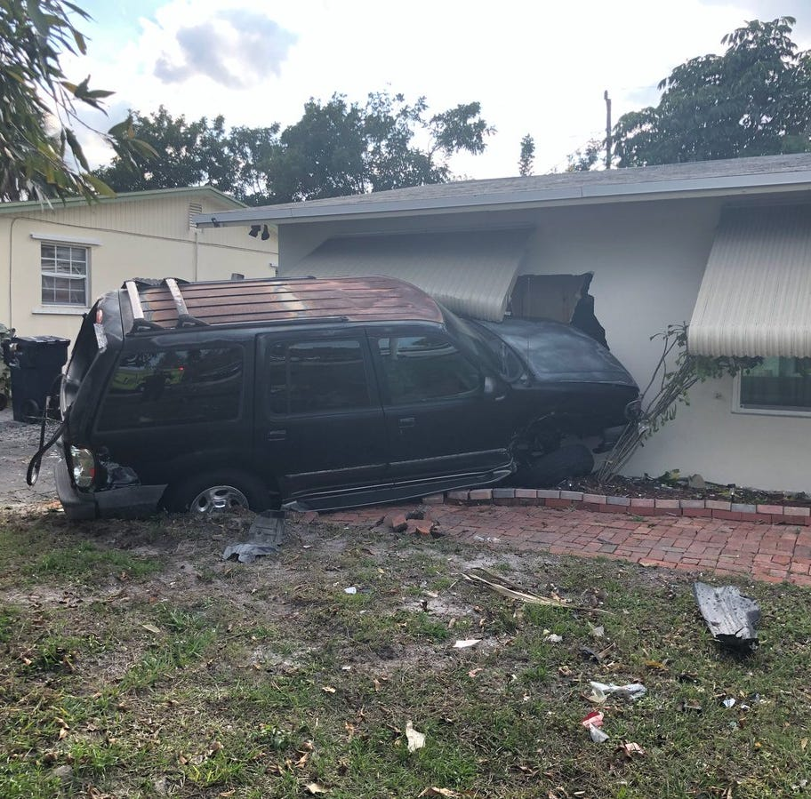 Car crash launches parked SUV through wall of Stuart house