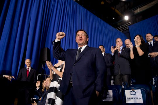 Florida Gov. Ron DeSantis arrives before President Donald Trump speaks to a Venezuelan-American community at Florida Ocean Bank Convocation Center at Florida International University in Miami, Fla., Monday, Feb. 18, 2019, to speak out against President Nicolas Maduro's government and its socialist policies.