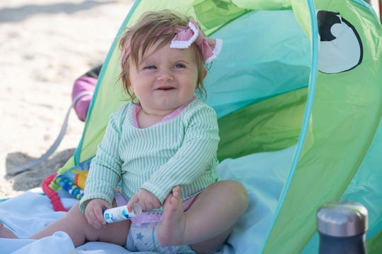 Using a variety of sunscreens, the Pelc family, including Cora Pelc, 8 months old, of Arendtsville, Pa., spent a sunny day at Bathtub Reef Beach on Friday, Feb. 15, 2018, on Hutchinson Island in Martin County. All but one of the sunscreens being used by the family contained the common, coral-damaging chemicals oxybenzone and octinoxate. The largest coral reef in North America, the Florida Reef Tract, stretches 360 miles between the St. Lucie Inlet and the tip of the Florida Keys.