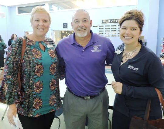 Emily Mass, left, of Indian River State College; Mike Sancho, vice president of operations for Boys & Girls Clubs of Martin County and Anna Valencia Tillery of White Glove Moving.