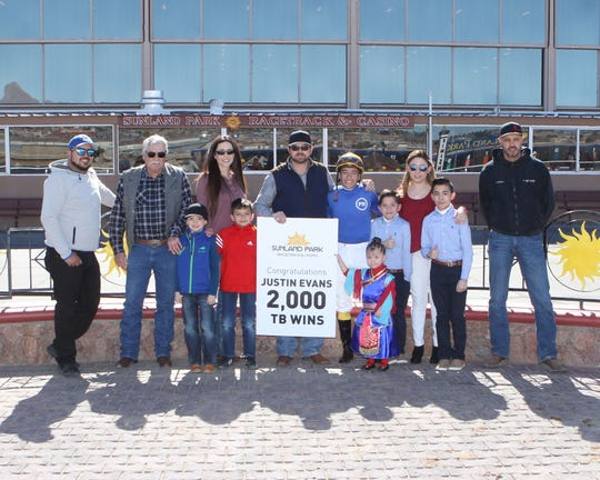 Trainer Justin Evans, center, won his 2,000th race on Sunday at Sunland Park Racetrack & Casino. The winning horse was Curlina Curlina with jockey Luis Contreras aboard.