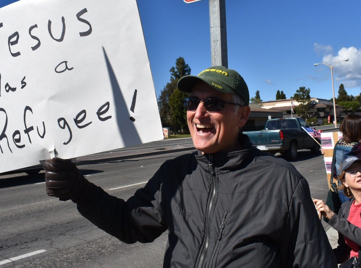 Walt Dunlop, of Ventura, expresses his views in a rally protesting President Trump's national emergency declaration.
