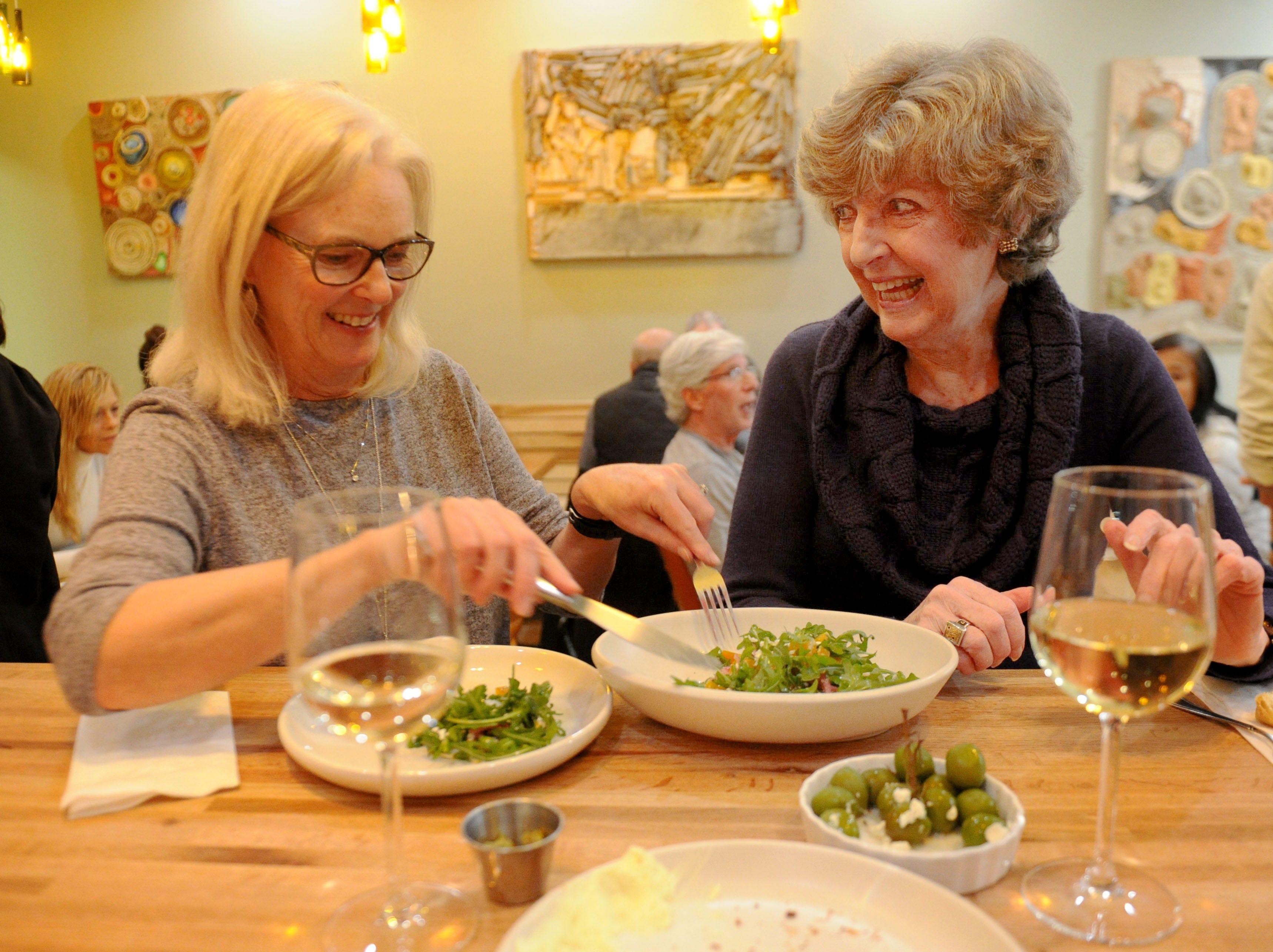 Susan Bevan, left, and  friend Carole Gordon share the roasted beet salad at the Decker Kitchen in Westlake Village.