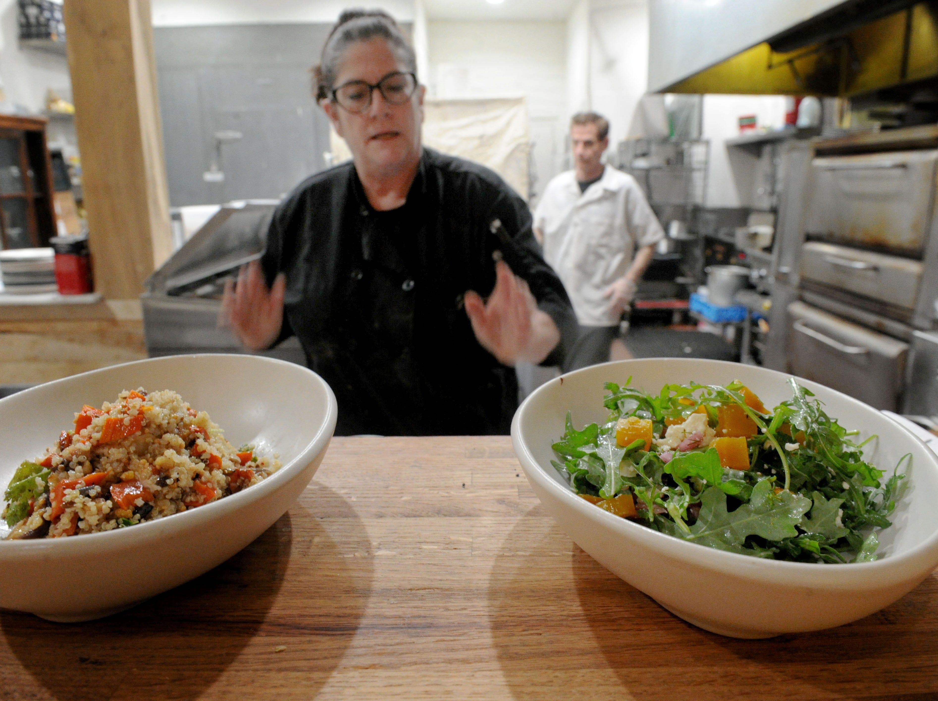 Robin Carpenter, cook at the Decker Kitchen in Westlake Village, serves charred vegetable quinoa and roasted beet salad.