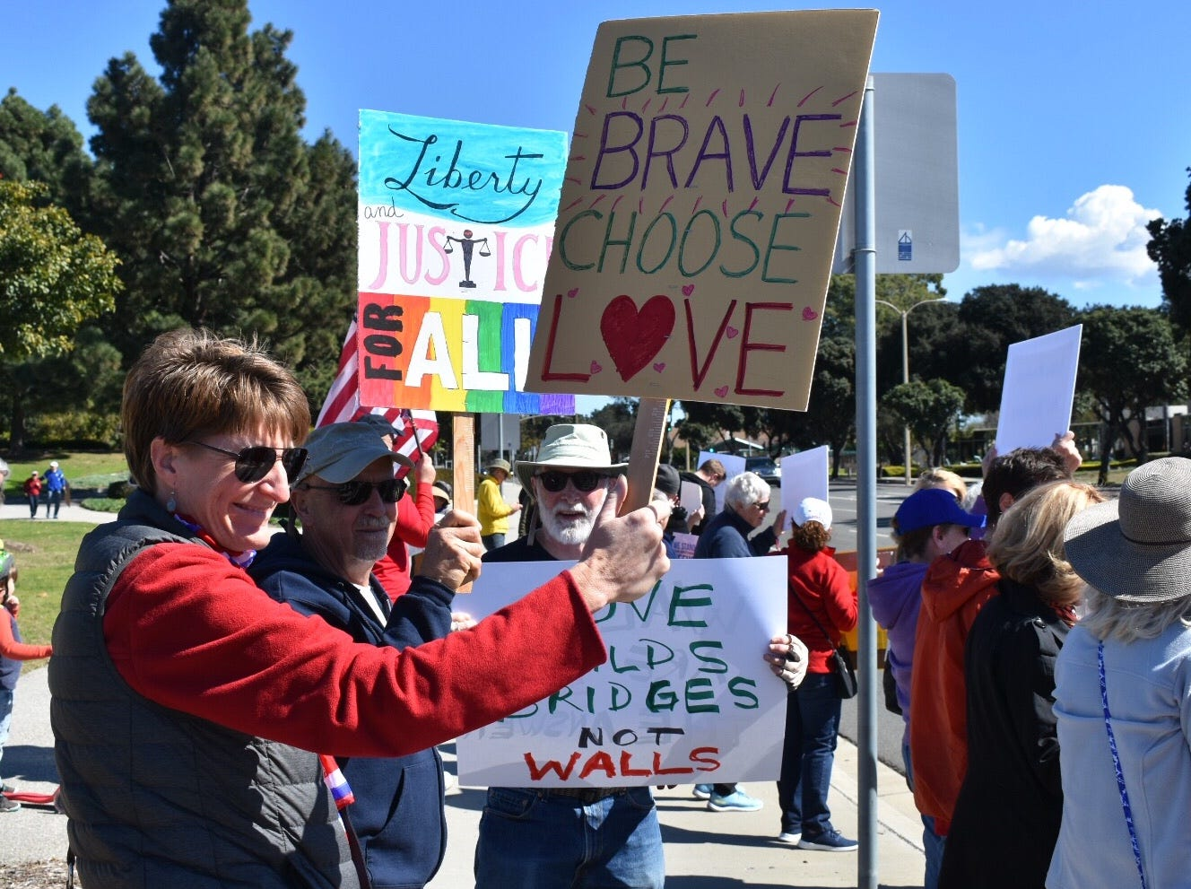 Melissa Henry, left, and nearly 200 others protested President Trump's emergency declaration order in a Ventura rally Monday.