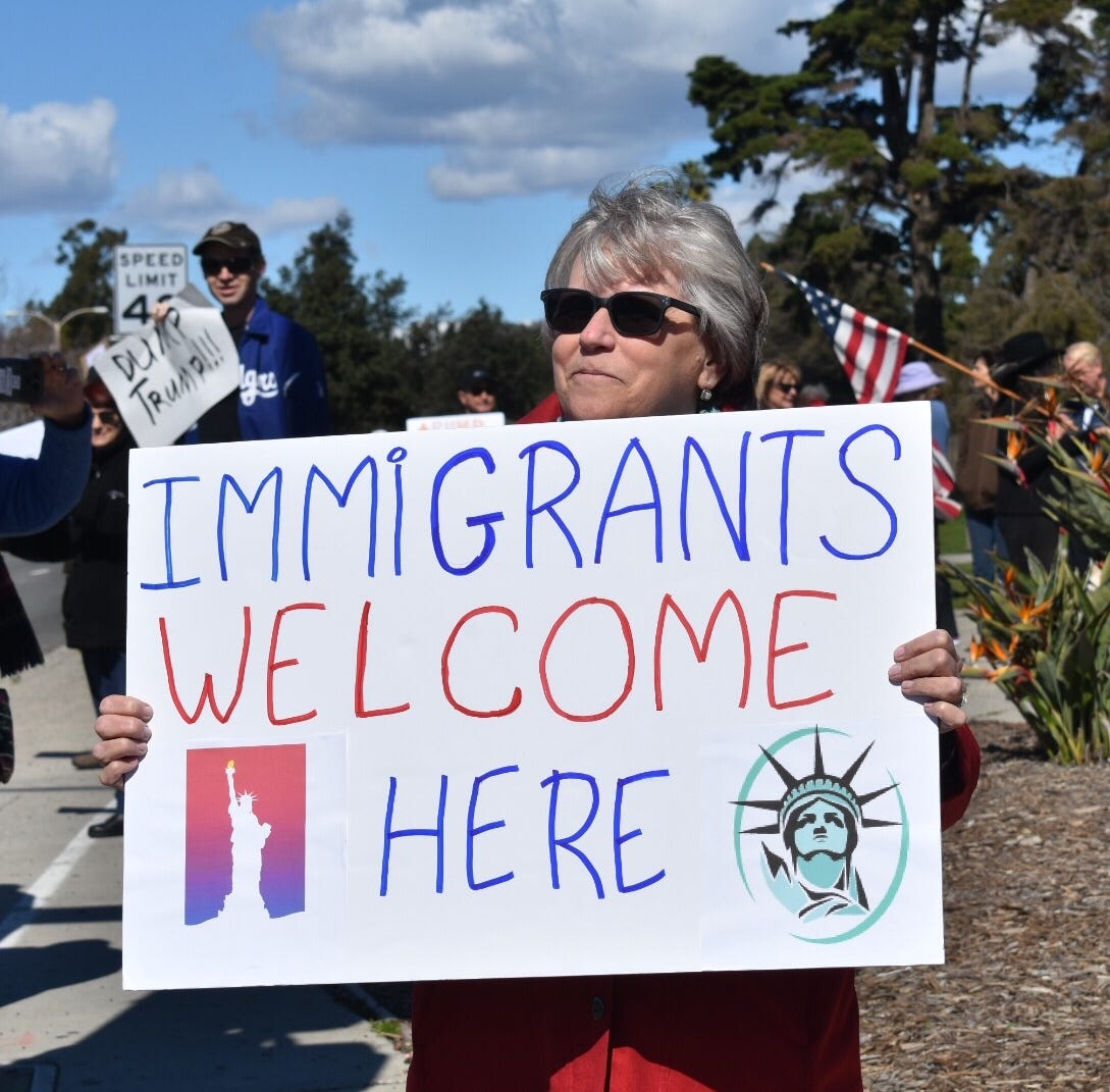 Local protesters focus anger at Trump's emergency declaration at Presidents Day rally