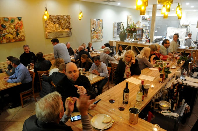 A packed house dines at the Decker Kitchen in Westlake Village. The restaurant features local vegetables, beer and wine.