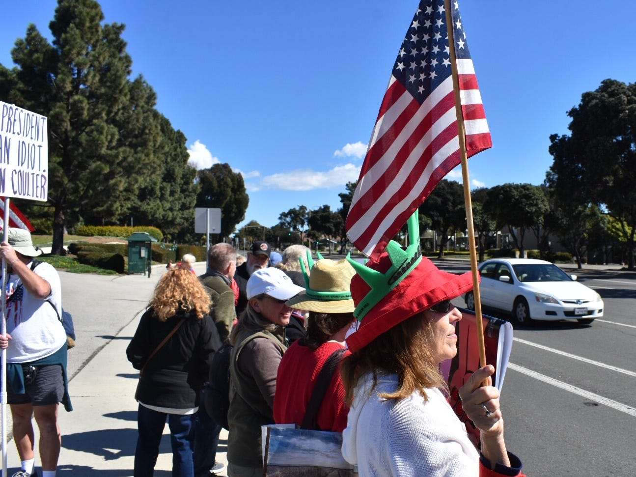 Sharon Ruiz, of Ventura, wore a Statue of Liberty crown at a Presidents Day rally Monday.