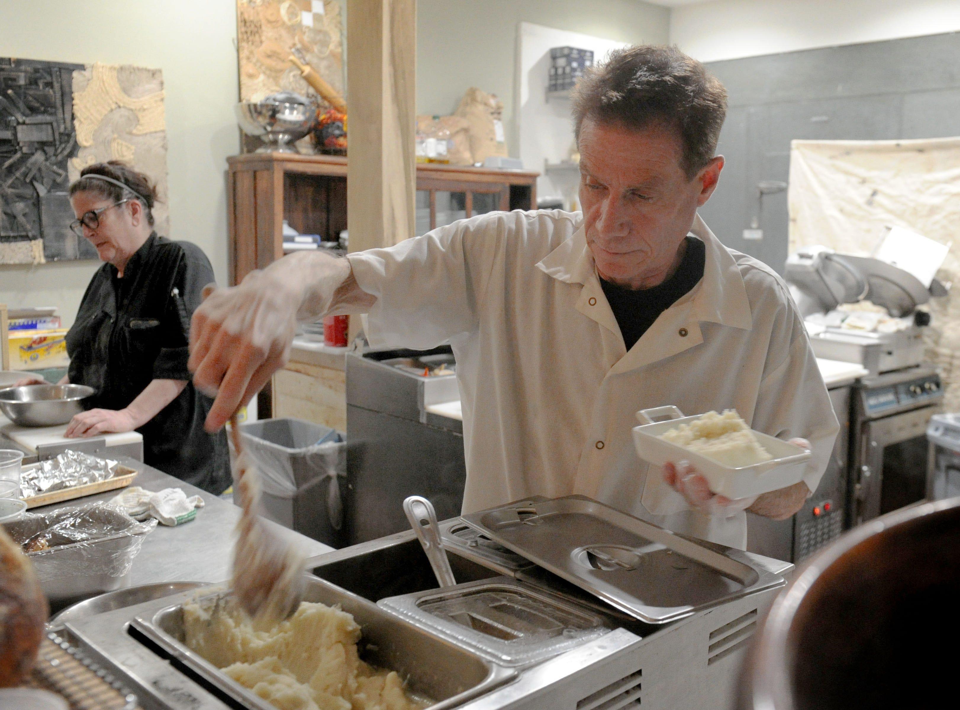 Rick Rosenblum, cook at the Decker Kitchen in Westlake Village, serves mashed potatoes.
