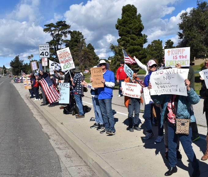 Nearly 200 people gathered at a Ventura intersection on Monday to protest President Donald Trump's national emergency order.