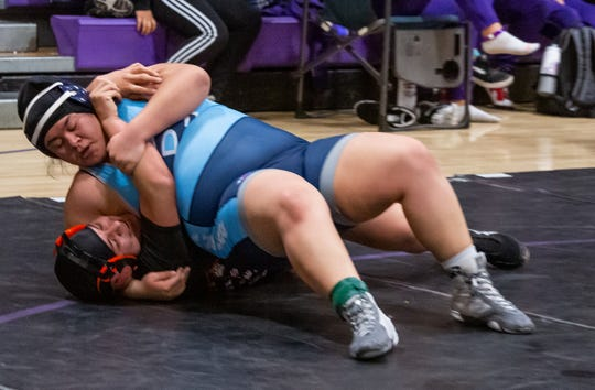 Redwood's Lynice Luna wrestles Selma's Arykah Cuavas on Saturday in the 235-pound Central Section Masters championship match in Lemoore