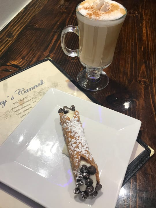 A chocolate chip cannoli with cappuccino at Joey's Cannoli in New Rochelle. Photographed Feb. 16, 2019.