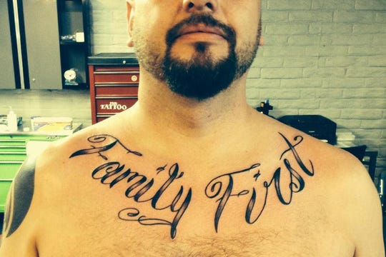 """Timothy Harper, shot and killed in Jamaica Feb. 16, 2019, had a tattoo on his chest that read """"family first."""""""