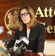 Delaware Attorney General Kathleen Jennings gives recommendations on criminal justice reform at a press conference Monday.