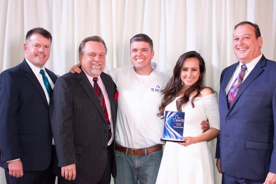 Keith and Ivonne Wineinger, center and center right, of The Burn Shop celebrate being named 2018 New Member of the Year by the Wichita Falls Chamber of Commerce. Pictured at left, Chamber president Henry Florsheim. The New Member award goes to a business that recently joined the chamber and immediately made a big splash.  Odd Duck Coffee won for 2017.