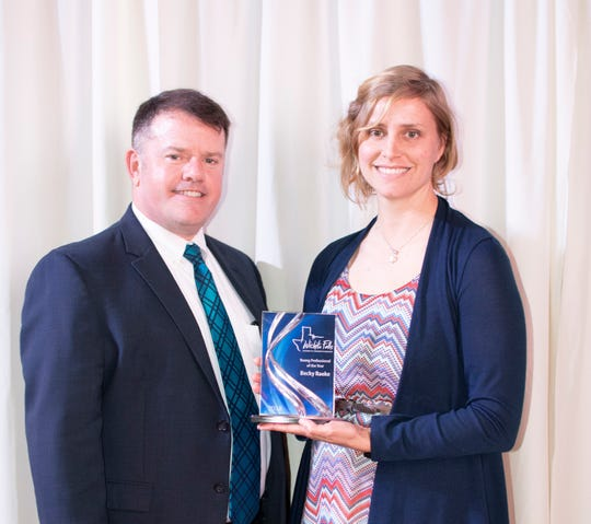 Becky Raeke, right, of Farmers Insurance, received the Young Professional of the Year award from the Wichita Falls Chamber of Commerce. Chamber President Henry Florsheim is pictured at left.