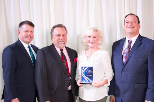 """Lisa Pettyjohn, second from right, was named 2018 Chamber Champion at the recent Wichita Falls Chamber of Commerce annual meeting. Pettyjohn, of P.E.T.S. Low Cost Spay & Neuter Clinic, was honored as someone who has """"gone above and beyond to promote the chamber and help our efforts,"""" the chamber stated."""