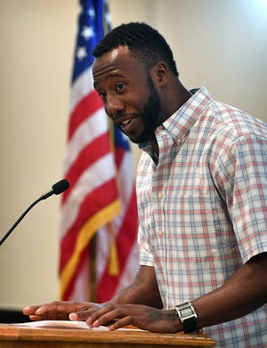 Markelle Martin, a teacher and coach with the Burkburnett ISD, speaks Monday during a luncheon with the Wichita County Republican Women.