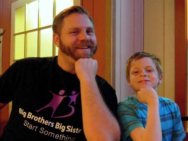 """Big"" Nick and ""Little"" Gavin flexing their muscles at BBBS' annual Bowl for Kid's Sake."