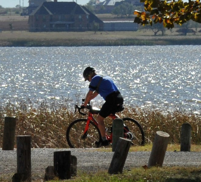 In this file photo, a cyclist rides near Lake Wichita. The Bike Friendly Action Team will host their first event March 9 at the lake.