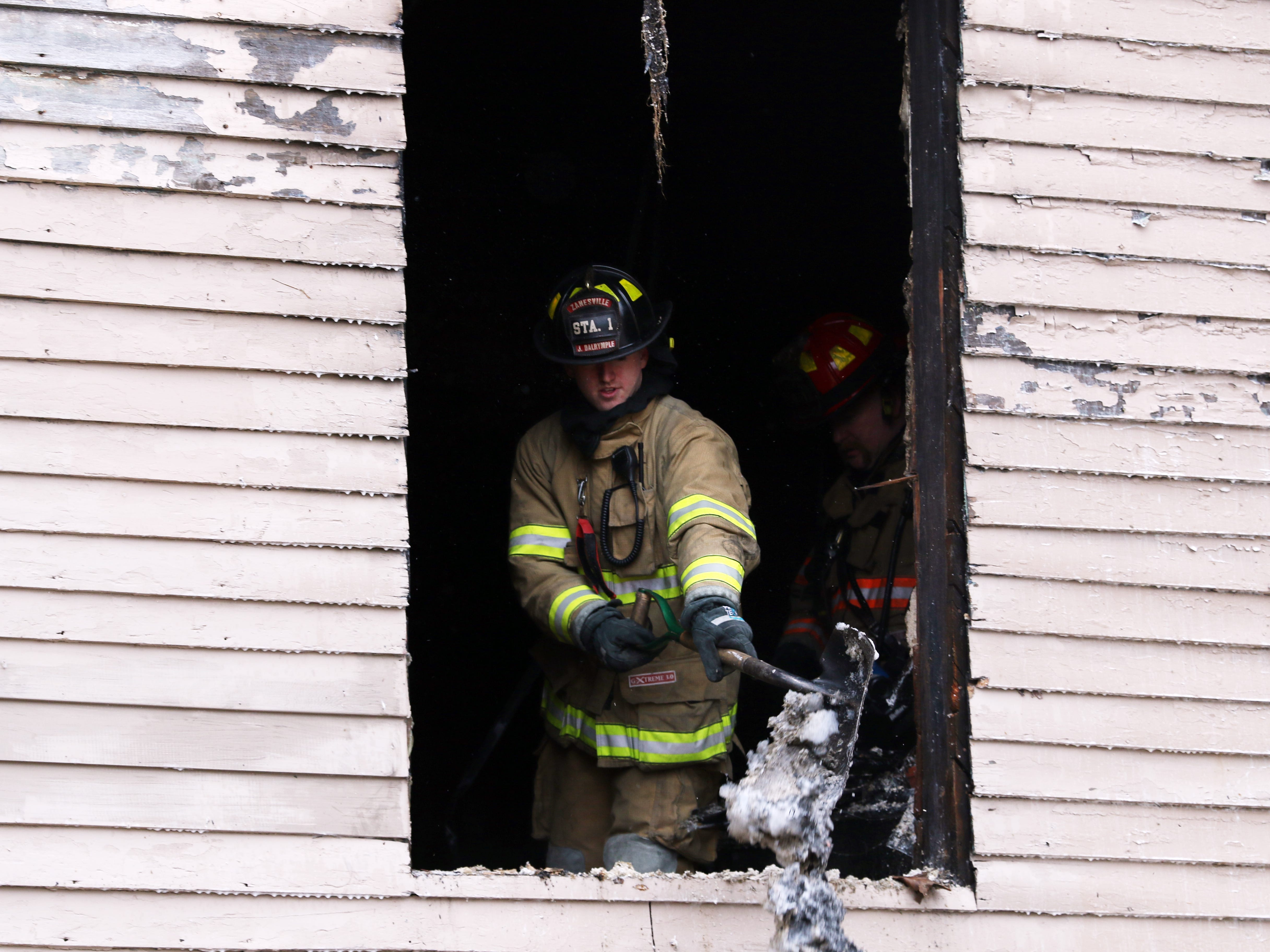 The Zanesville Fire Department fought a fire at 924 Maple Avenue in Zanesville Monday afternoon. Two people were taken to the hospital because of the blaze.
