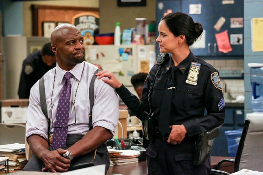 'Brooklyn Nine-Nine' co-stars Terry Crews, left, and Melissa Fumero will both appear on Monday's finale of 'America's Got Talent: The Champions.'