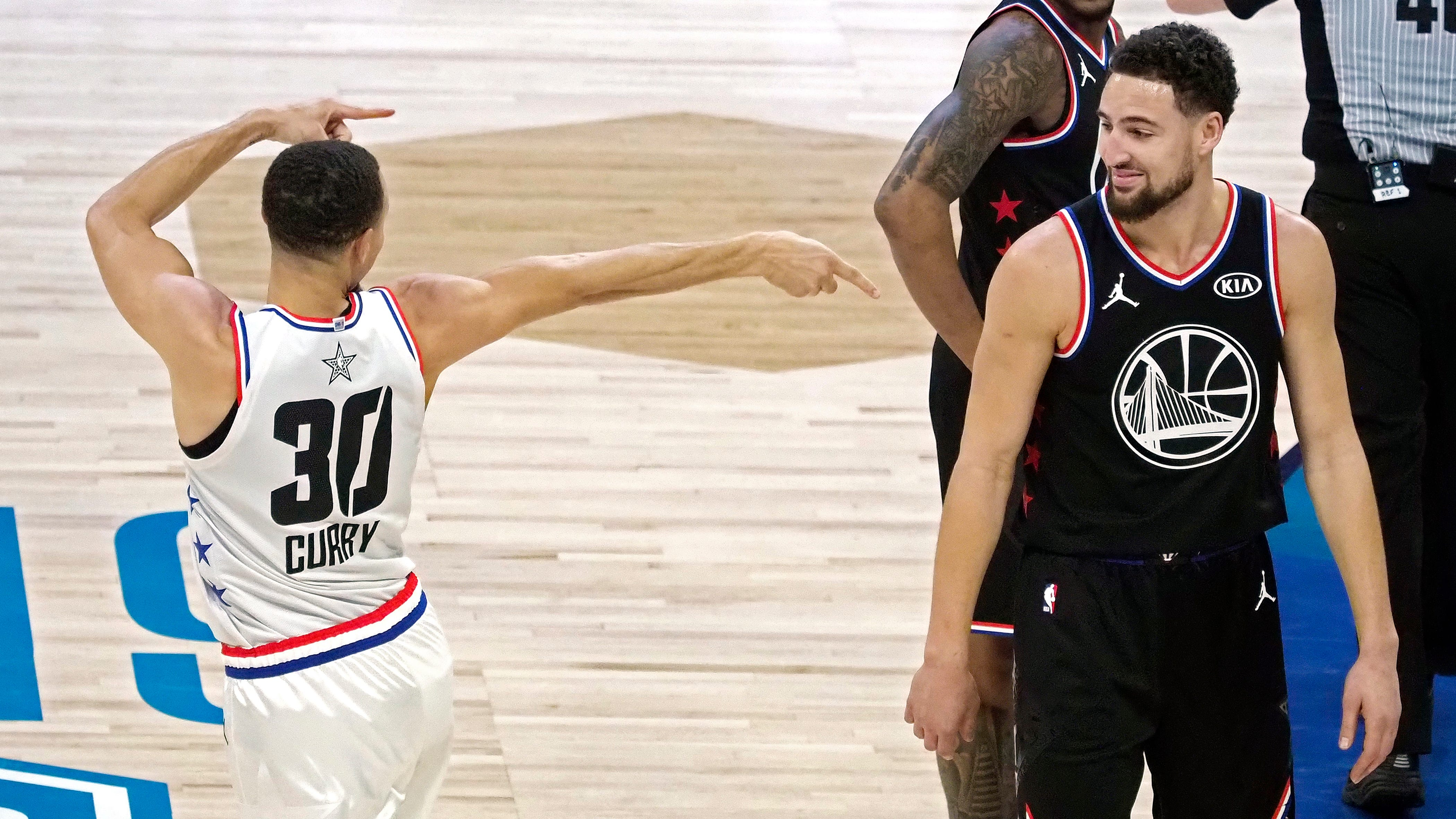 Stephen Curry points at Klay Thompson after being fouled during the NBA All-Star Game.