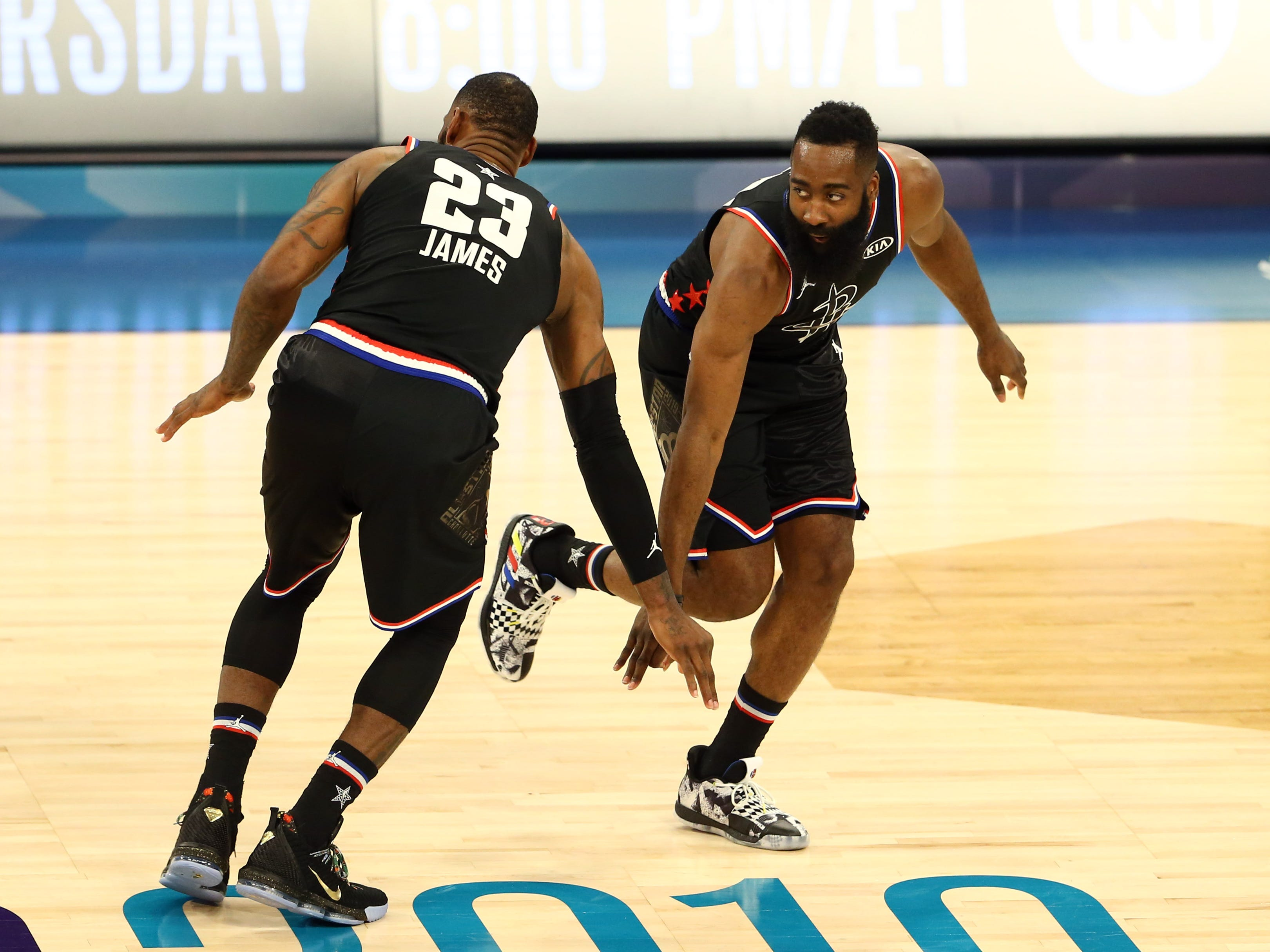 LeBron James and James Harden celebrate during the All-Star Game.