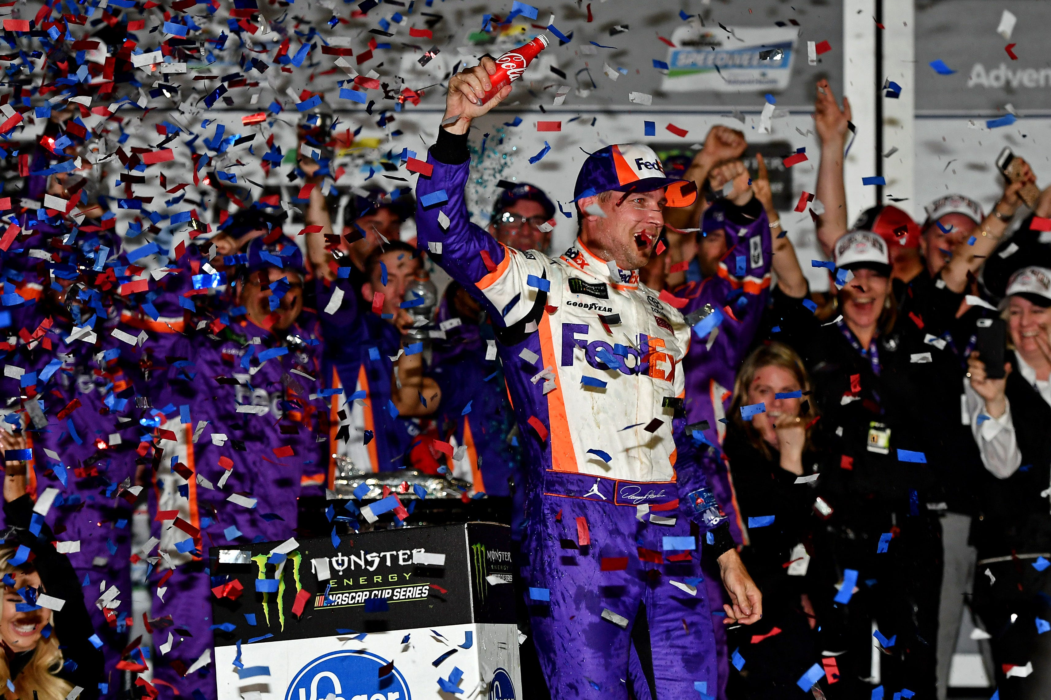 NASCAR Cup Series driver Denny Hamlin celebrates winning the Daytona 500 at Daytona International Speedway.