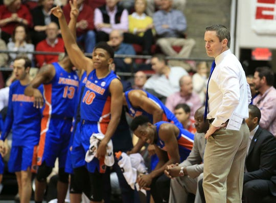 Florida Gators coach Mike White looks back at his team during his team's win over Alabama.