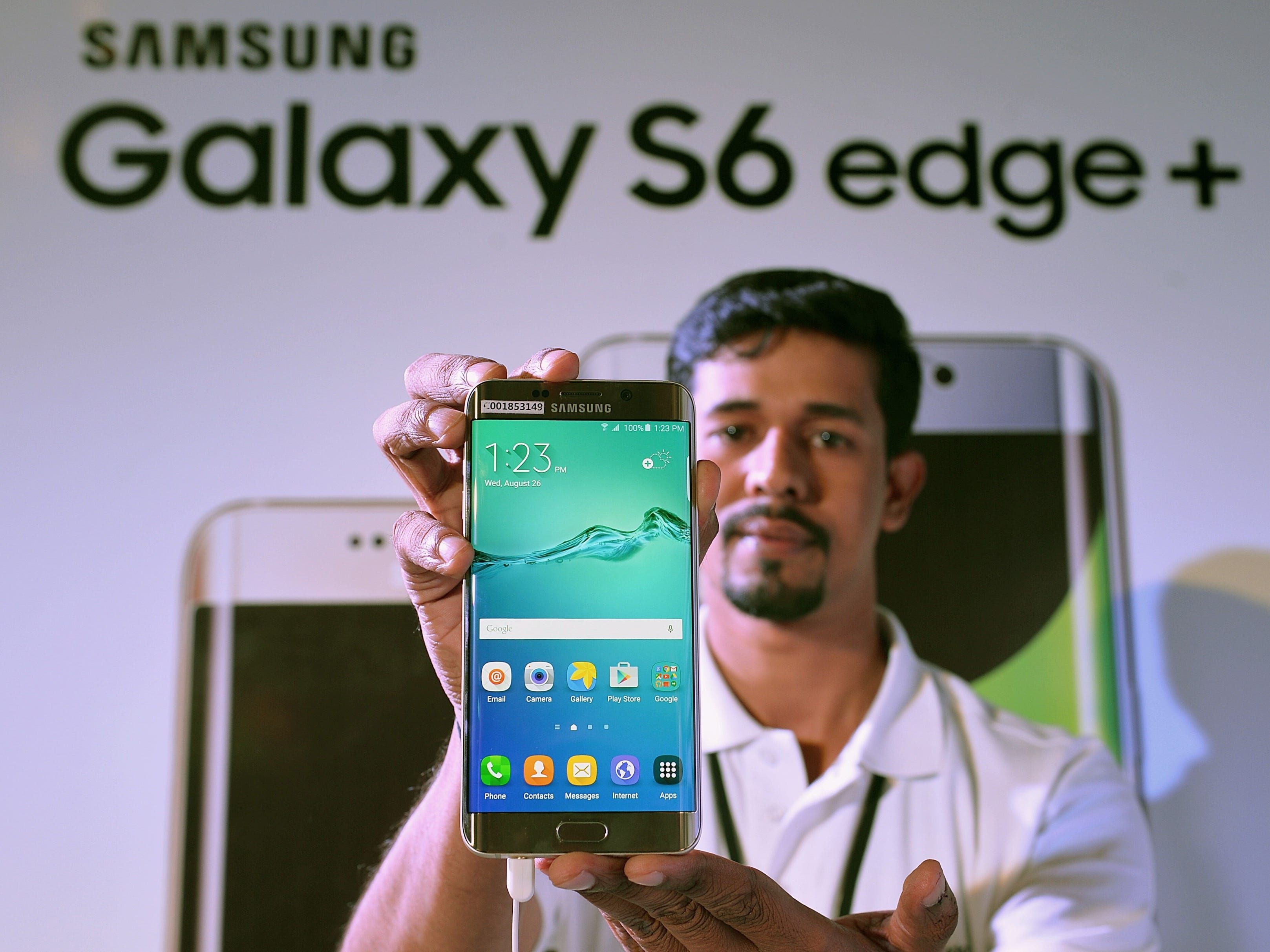 A salesman shows a Galaxy S6 Edge +  in Bangalore on August 26, 2015.