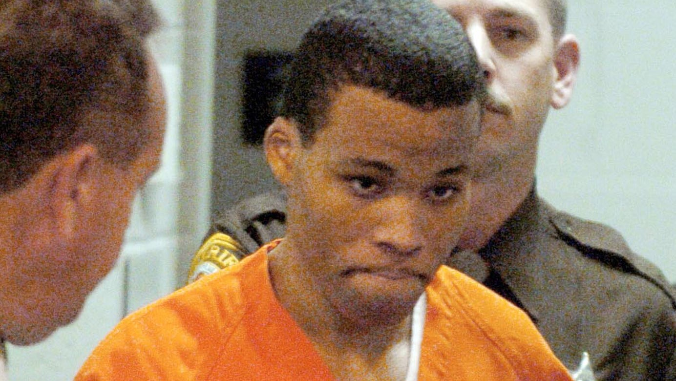 Convicted sniper Lee Boyd Malvo enters a courtroom in Spotsylvania, Va., two years after the 2002 attacks that terrorized the Washington, D.C., area.