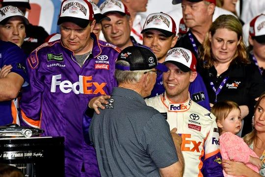 Denny Hamlin celebrates with team owner Joe Gibbs and the No. 11 crew after winning Daytona 500.