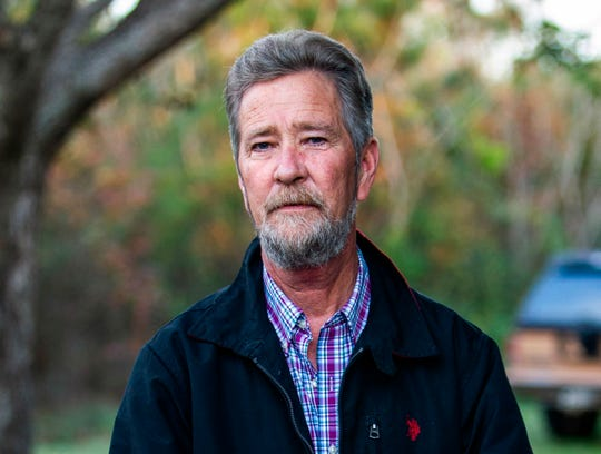 Political operative Leslie McCrae Dowless Jr. stands outside his home in Bladenboro, North Carolina, on Dec. 5, 2018.