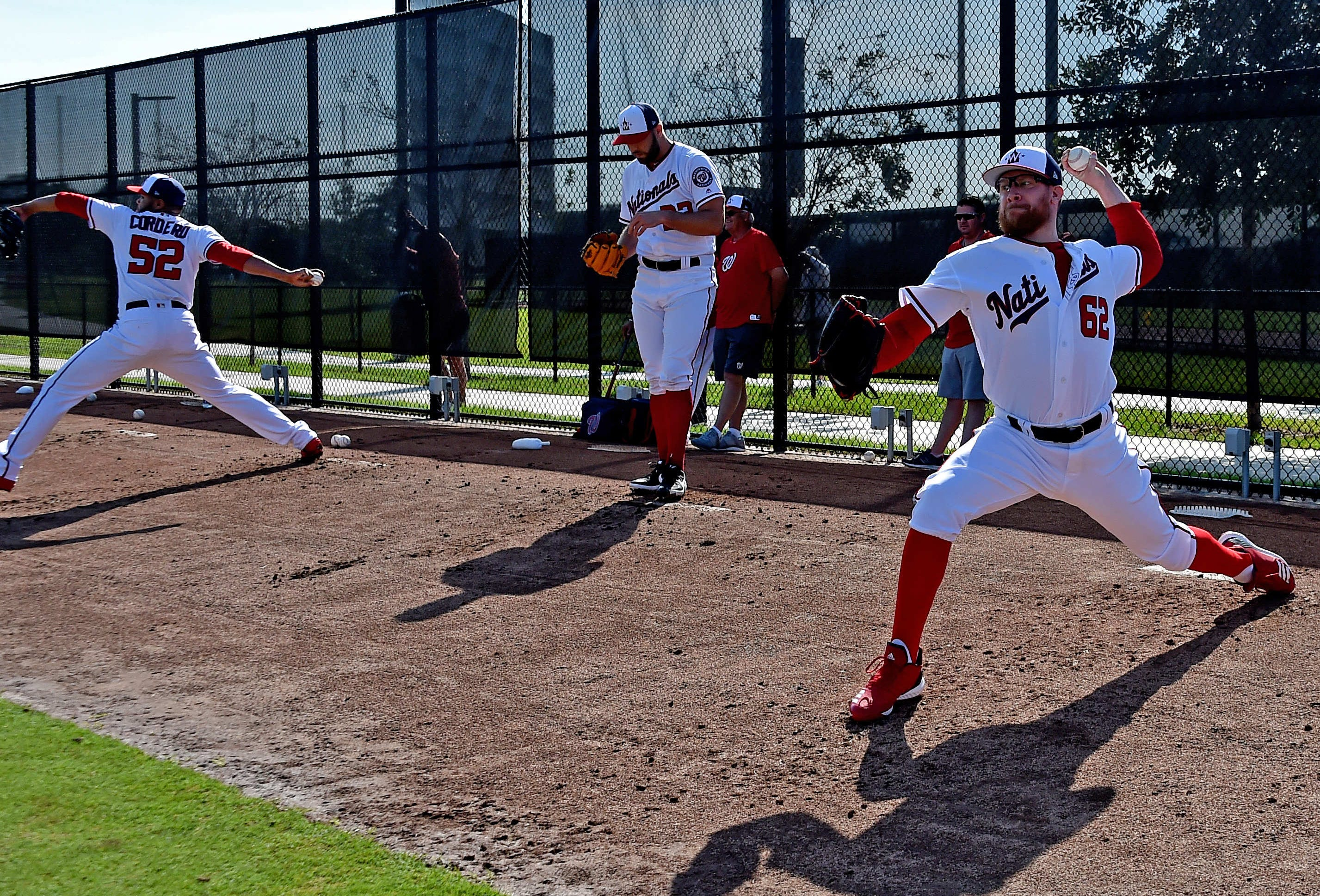 Sean Doolittle and Nationals pitchers throw at camp on Saturday.