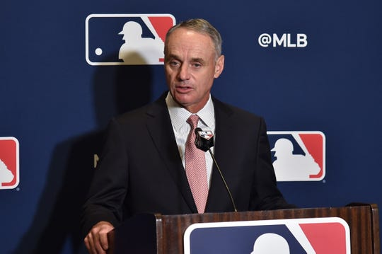 MLB commissioner Rob Manfred answers questions Sunday at spring training media day in West Palm Beach, Fla.