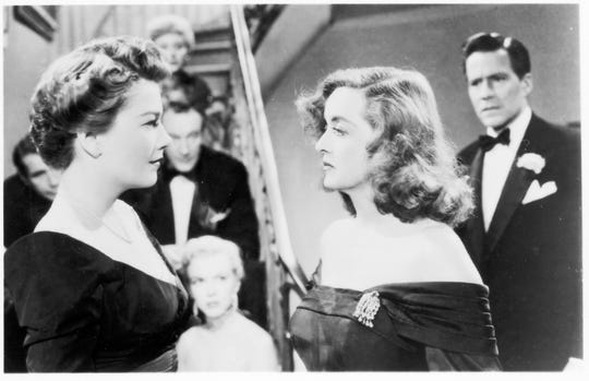"""An ambitious understudy (Anne Baxter, left) sets her sights on the stardom of a Broadway actress (Bette Davis) in """"All About Eve."""""""