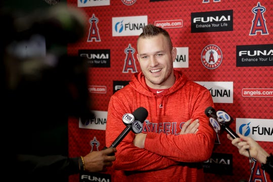 Mike Trout talks to the media during a news conference on Monday.