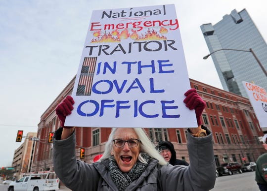 Cathy Clark protests President Donald Trump's emergency declaration in downtown Fort Worth, Texas, on Feb. 18.