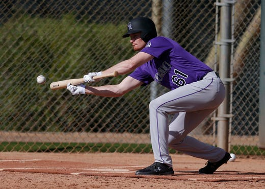 Feb. 16: Rockies pitcher Sam Howard practices bunting.