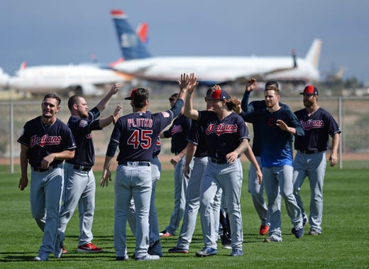 Feb. 18: Indians pitchers high-five during a workout.