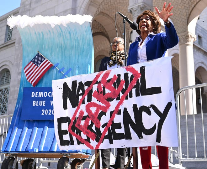 U.S. Rep. Maxine Waters, D-Calif., addresses a 2019 rally in Los Angeles protesting President Donald Trump's declaration of a national emergency to free up funding to build his border wall.