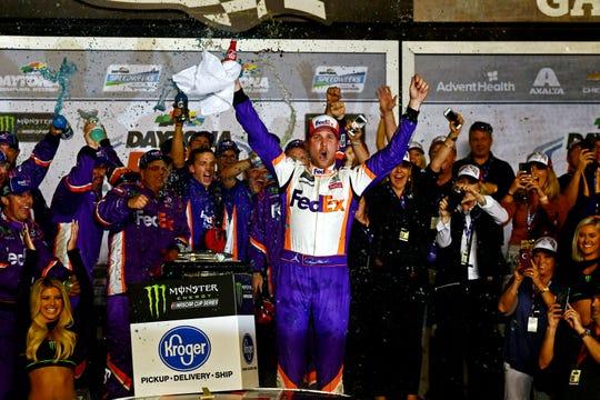 Denny Hamlin celebrates after winning the 61st annual Daytona 500 at Daytona International Speedway.