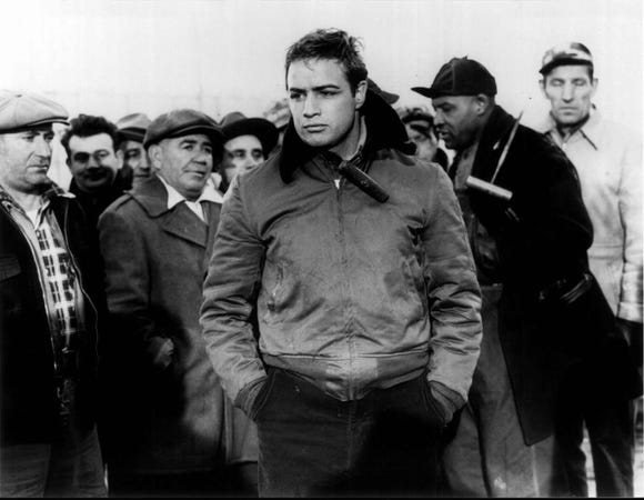 "Marlon Brando (center) stars as boxer-turned-longshoreman Terry Malloy in ""On the Waterfront."""