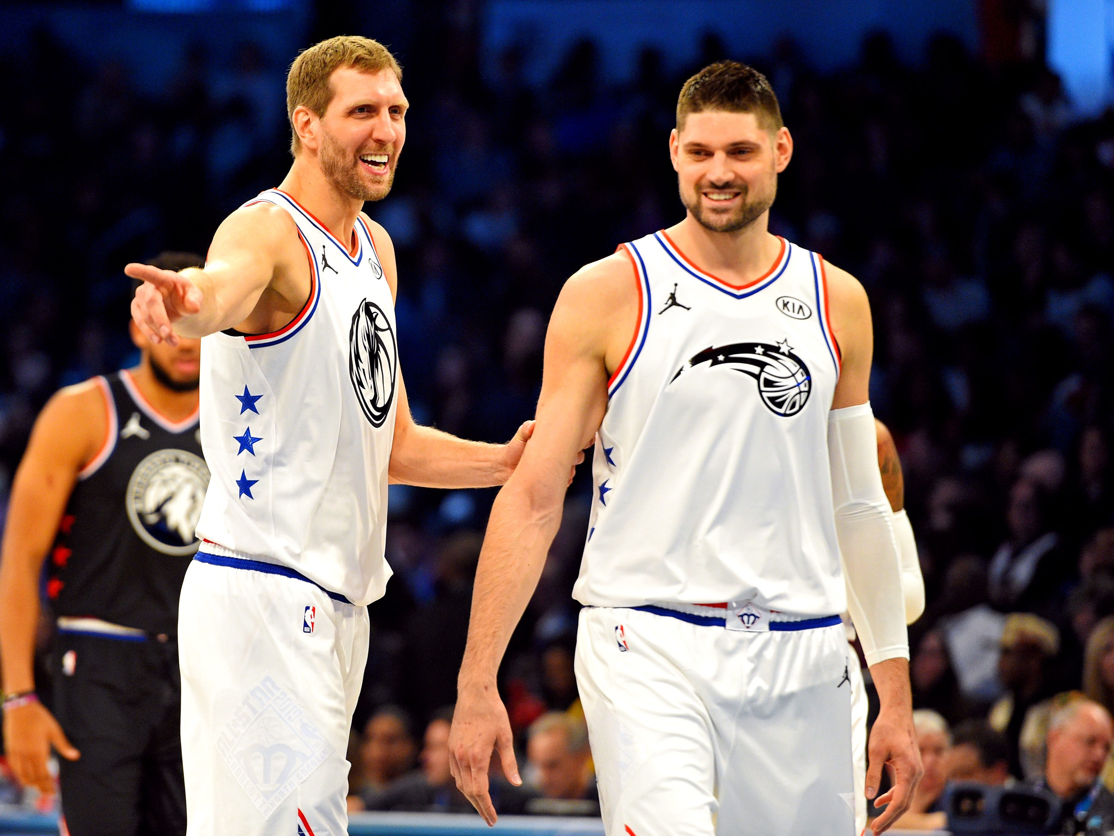 Dirk Nowitzki laughs with Nikola Vucevic during the All-Star Game.