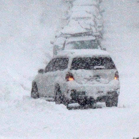 Drivers make their way up and down a snow-packed street in South Lake Tahoe, Calif., Friday, Feb. 15, 2019.  A winter storm will spread weather misery across the nation from Tuesday to Thursday this week.