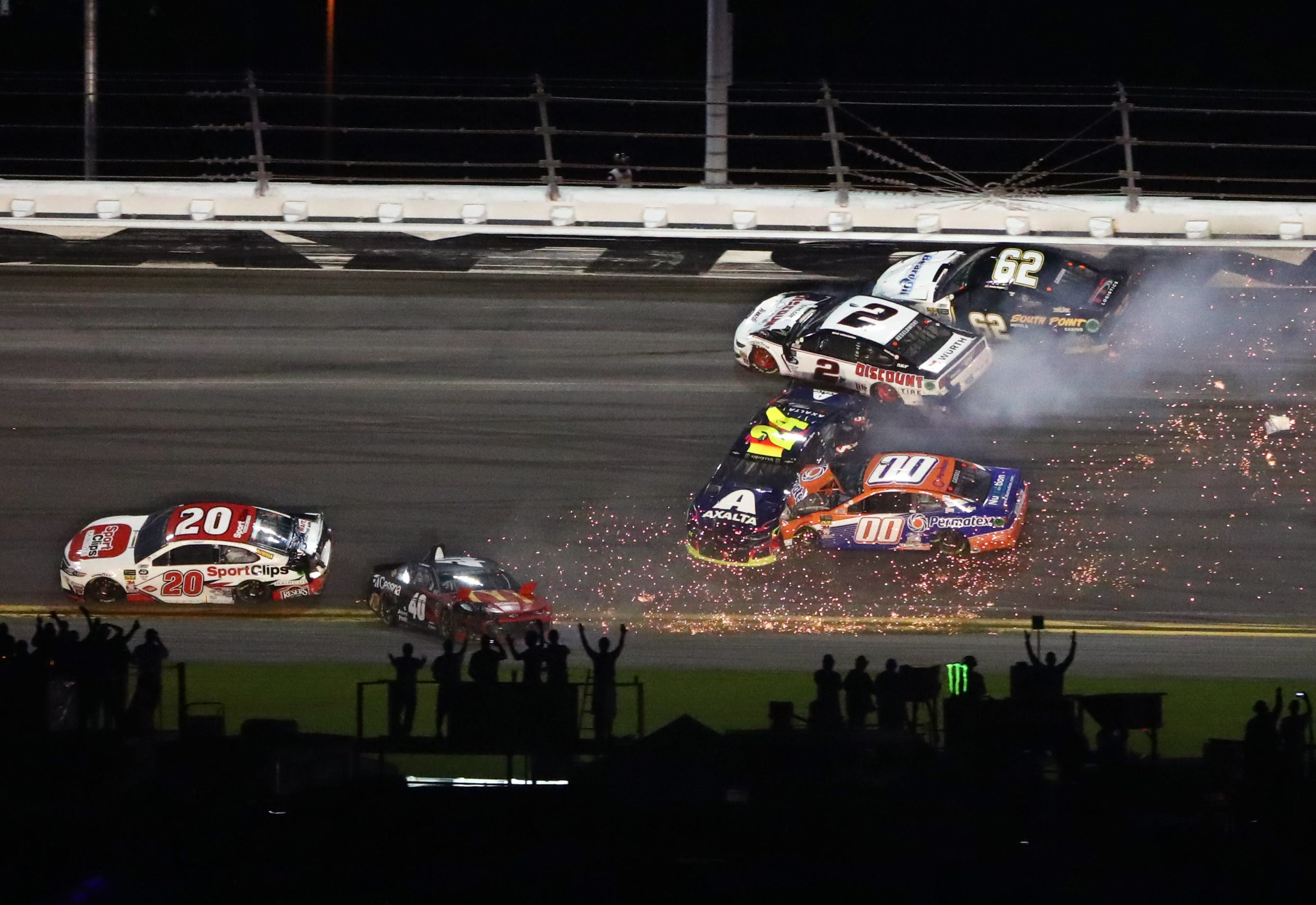 Wrecks cause late-race chaos, delays before Denny Hamlin wins Daytona 500 in OT
