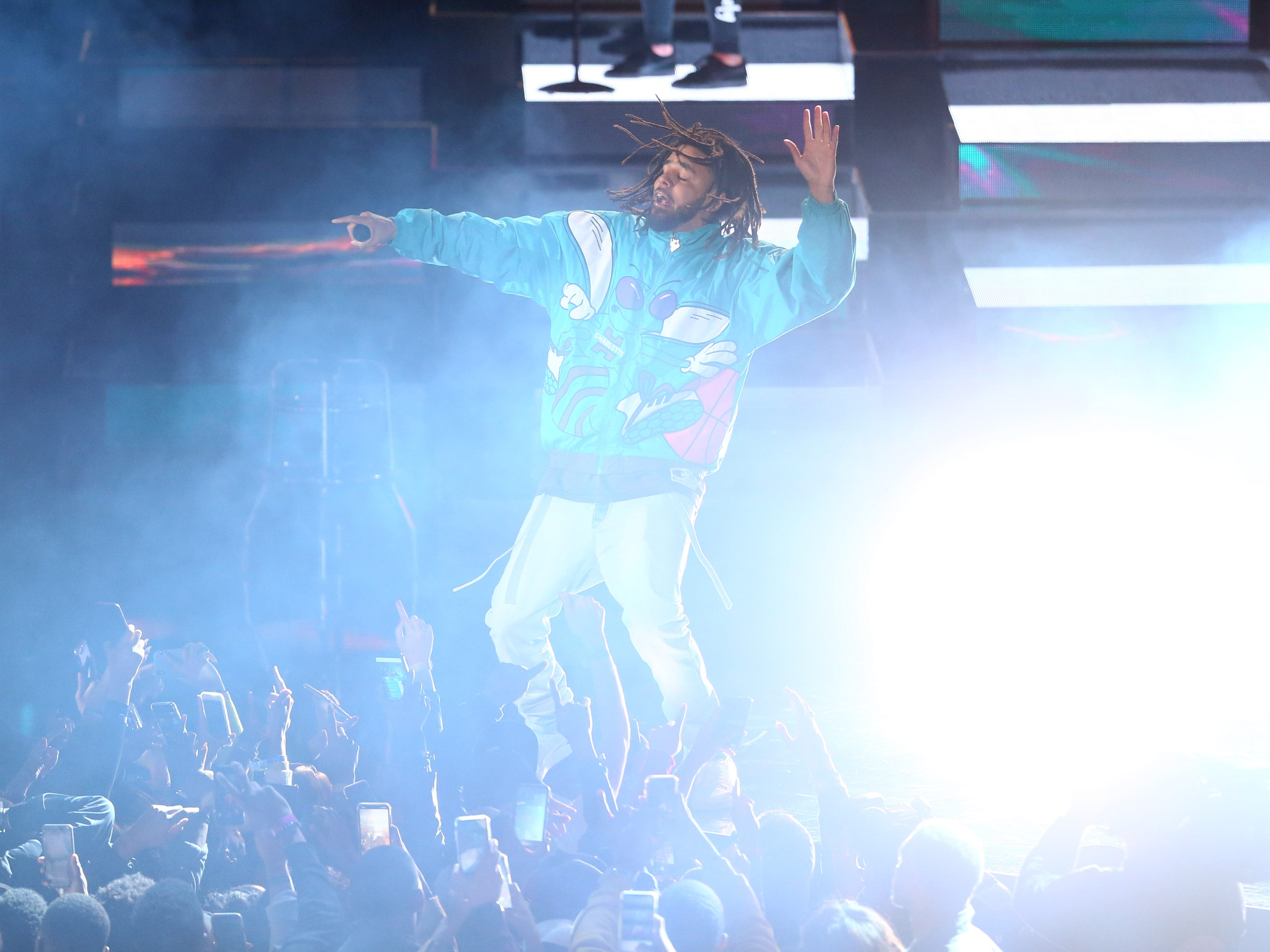 Recording artist J. Cole performs during the halftime show at the All Star Game.