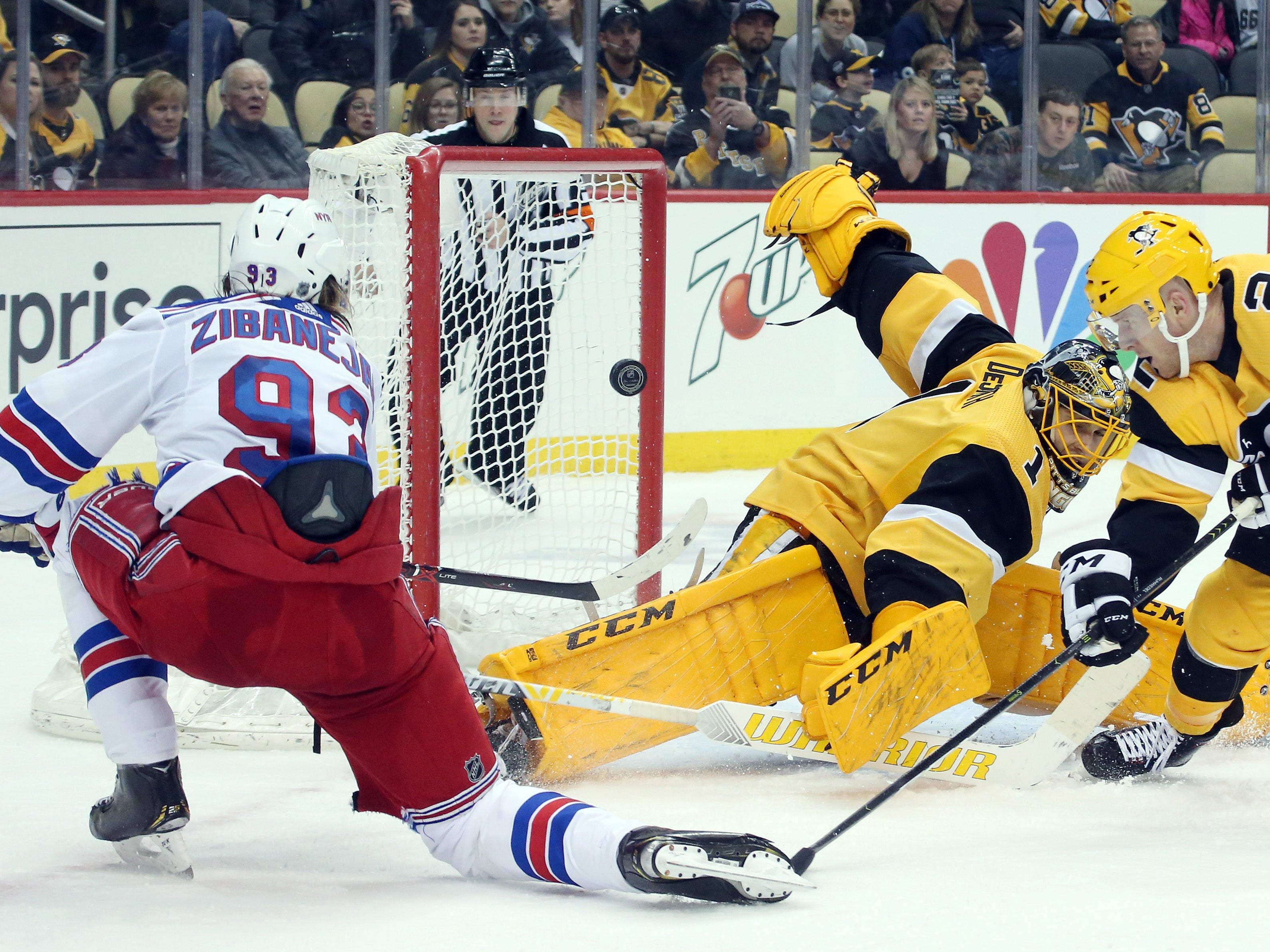 Feb. 17:  New York Rangers center Mika Zibanejad (93) scores a goal against Pittsburgh Penguins goaltender Casey DeSmith during the third period at PPG PAINTS Arena. The Penguins won the game, 6-5.